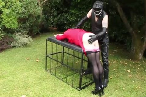 Leather Clad master thrashing Whipping shemale butthole In Garden