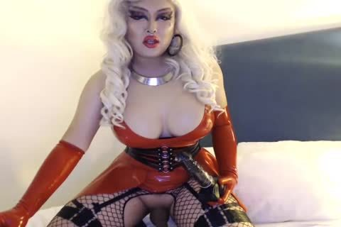 oriental Drag Latex Crossdresser Plays With penis And fake penis