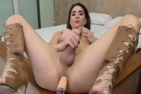 TS Adriana Rodrigues Wanks giant cock whilst A Machine Takes Care Of Her wazoo