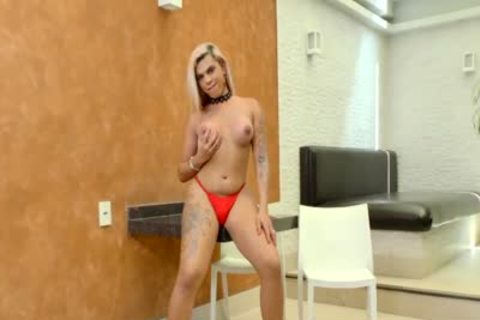 TS Bruna Aylla Teases In Red lingerie And Shoves A sex toy Up Her chubby ass